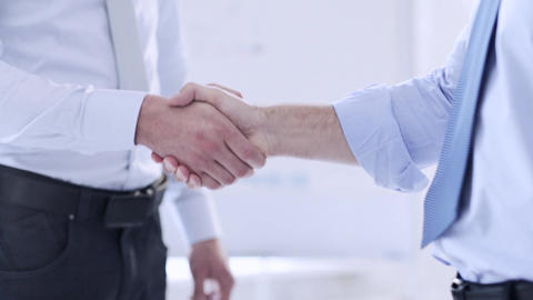 two businessmen shaking their hands Footage