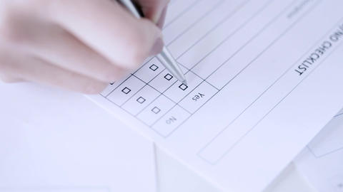 hands filling checklist and answering with yes Live Action