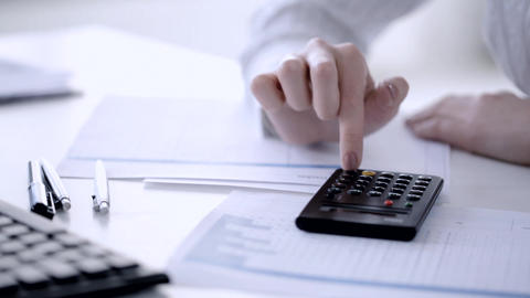 female accountant making fast calculations Footage