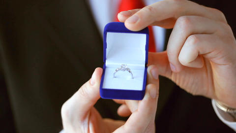 groom holding wedding ring Footage
