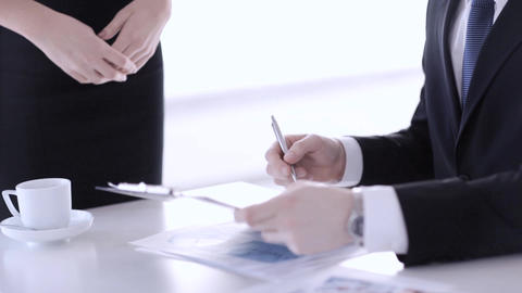 man signing a contract Footage