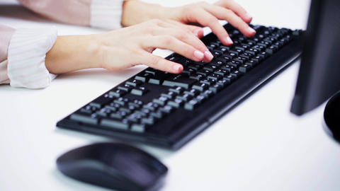 young businesswoman with computer typing at office Footage