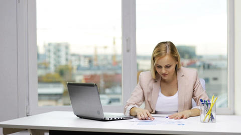 smiling businesswoman with laptop and papers Footage