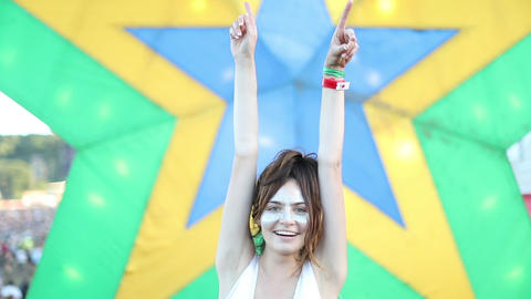 Young adult female having fun at summer festival ビデオ