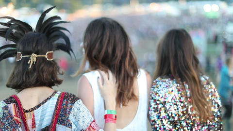Young adult female friends having fun at festival Footage