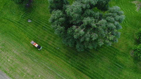 Aerial view of a lawnmower in a public park Footage