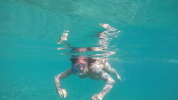 Girl approaching, swimming and snorkeling on a beach with turquoise waters, slow 영상물