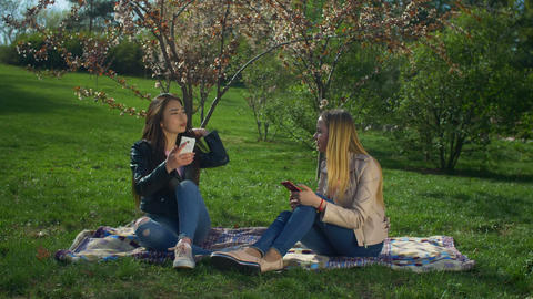 Diverse girls spending leisure in spring park Footage
