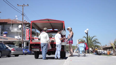 Fruit vendors selling their goods near the beach at the tourists who wander 82 Footage
