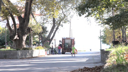 Garbage men that empty garbage bins in car service 12 Footage