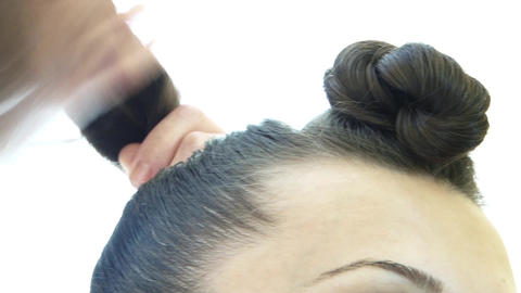 Hairdresser weaves his client's hair in a long pony tail 49 Footage