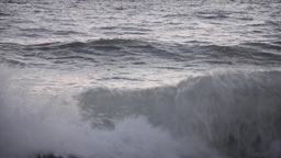 Yellow buoy in turbulent waves of the sea in early hours 44 Footage