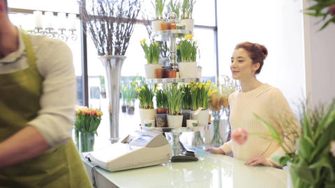 florist showing flowers to woman at flower shop Footage