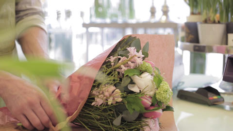 florist with flowers and customer at flower shop Footage