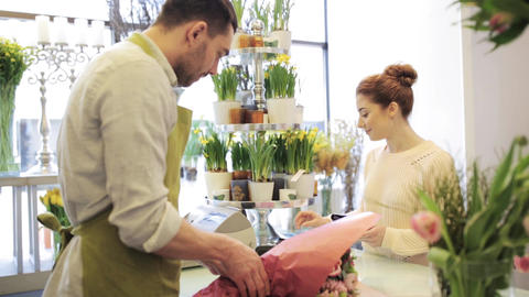 florist and woman buying flowers at flower shop Footage