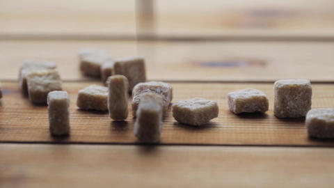 close up of brown sugar on wooden board or table Live Action