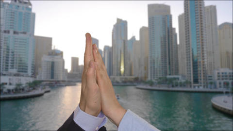 Coworkers giving high five with business city on background Footage