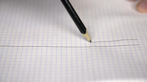 Hand drawing straight parallel lines with pencil on checkered paper in notebook Footage