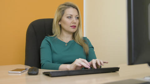 Portrait business woman working on office computer and taking mobile call Live Action