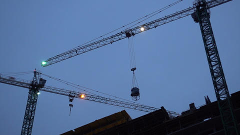 Construction Crane Works In The Evening Stock Video Footage