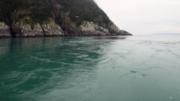 Whirlpool of water of Pacific Ocean on background amazing landscapes Alaska Footage