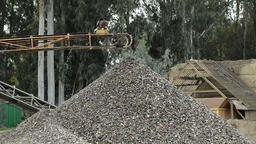 Old industrial pebbles conveyor putting down pebbles in a mountain in a quarry Footage