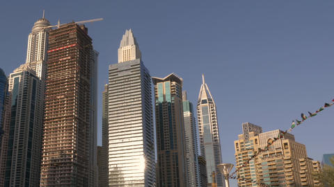 Businesspeople holding hands in lock with skyscrapers on background Footage
