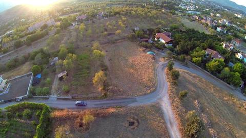Aerial Car driving through village road. Eski Datca Village Live Action
