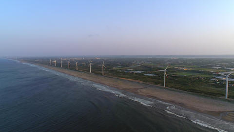 Aerial - Wind power plant lining the coast ライブ動画