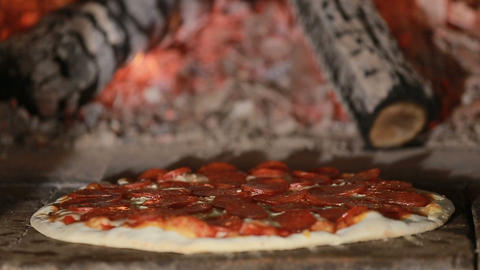 Pepperoni Pizza Baking in Wood Fired Oven Footage