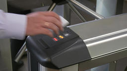 Hands of people apply electronic pass to turnstile wicket checkpoint in office Footage