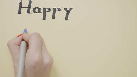 Woman hands whishing happy new year on a greeting card with a thick pen and Footage