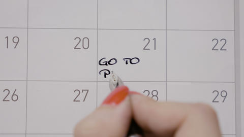 Student female hands writing with black pen on calendar go to pilates with Footage