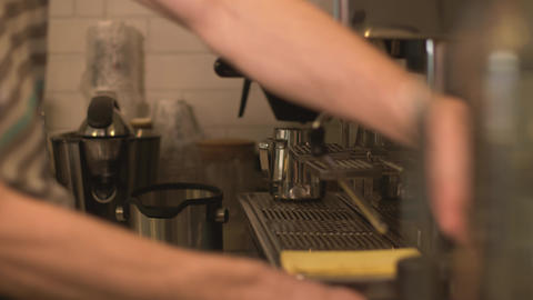 Barista preparing coffee with coffee machine in cafe kitchen. Man making coffee Footage