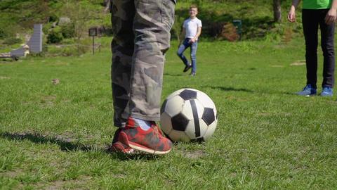 Three boys play football in park Footage