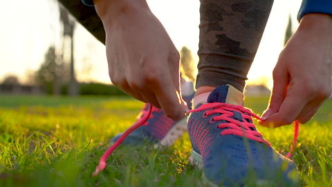 Running shoes - woman tying shoe laces Footage