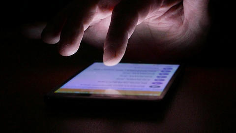 A man typing and searching on a touch screen smartphone GIF
