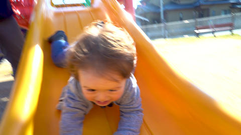 Toddler boy playing on the playground GIF