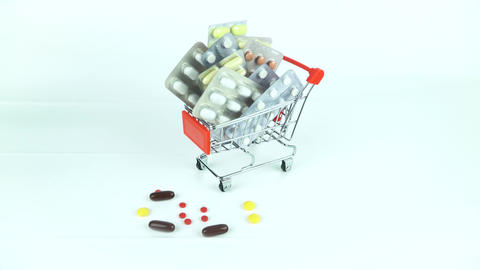 medicines in mini market trolley. White background covered Archivo