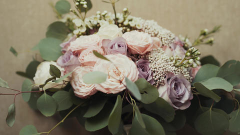 Beautiful bridal bouquet on the table GIF