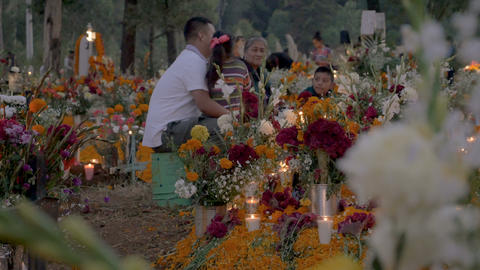 TZURUMUTARO, MEXICO - NOVEMBER 1, 2016 - Multi generational family sitting and Footage