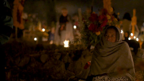 TZURUMUTARO, MEXICO - NOVEMBER 1, 2016 - Single old woman sitting in a cemetery Footage