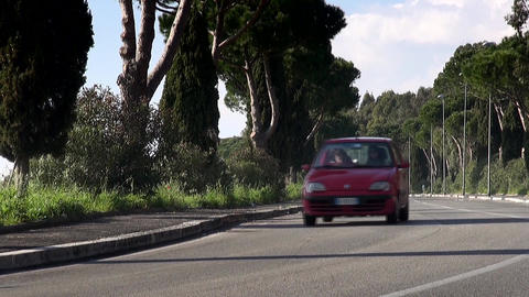 Italian Red Car Passing on Countryside Road Footage