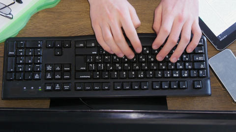 Overhead Of Man Working At Desk stock footage