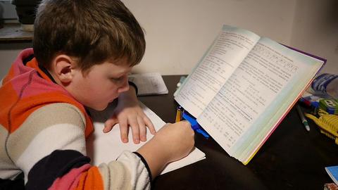Boy Doing Homework Slow Motion Footage