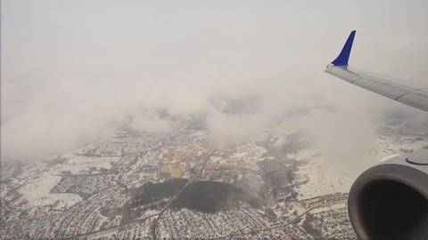 View from the descending aircraft on clouds Footage