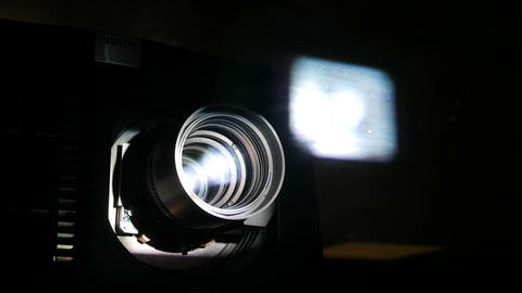 Motion picture projector lens, power beam shine through glass and optic Footage