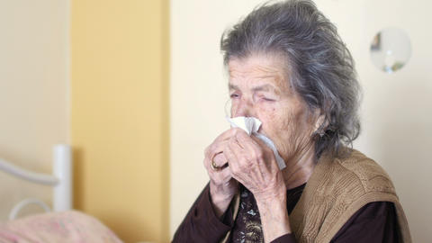 unhealthy old woman get flu cold, blowing nose Footage