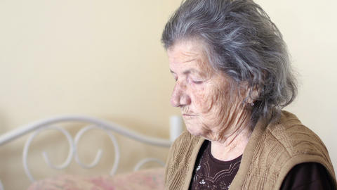 unhealthy old woman get support for eating, feed by daughter Live Action
