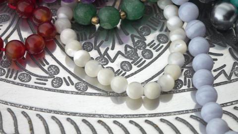 Gemstone jewelry turning slowly Live Action